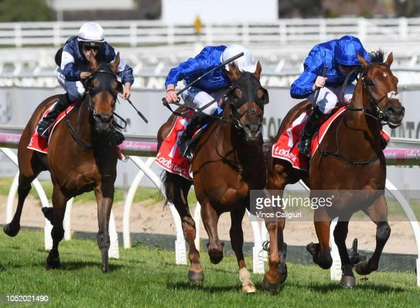 Pat Cosgrave riding Benbatl defeats James Doyle riding Blair House in Race 8 Ladbrokes Stakes during Melbourne Racing at Caulfield Racecourse on...