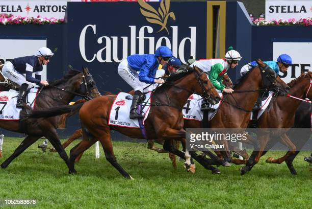 Pat Cosgrave riding Best Solution approch the first turn before winning Race 8 Stella Artois Caulfield Cup during Caulfield Cup Day at Caulfield...