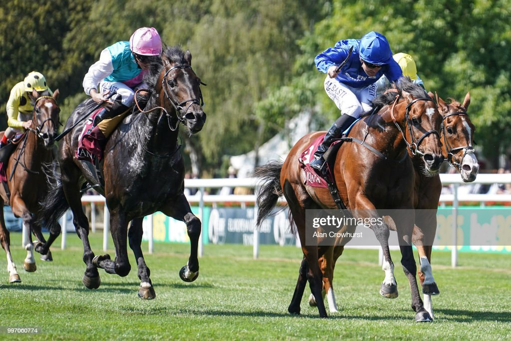 Pat Cosgrave riding Best Solution (R, blue) win The Princess Of Wales's Arqana Racing Club Stakes at Newmarket Racecourse on July 12, 2018 in Newmarket, United Kingdom.