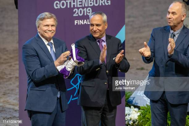 Pat Cristenson President of Las Vegas Events the organizer of the 2020 FEI World Cup Finals receives the FEI flag from FEI President Ingmar De Voss...