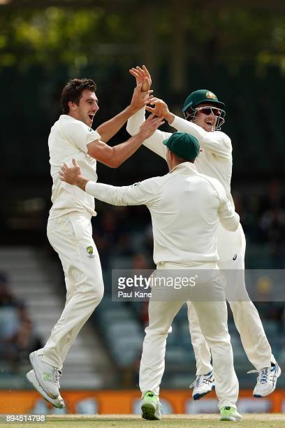 Pat Cummins and Cameron Bancroft of Australia celebrate the wicket of Stuart Broad of England during day five of the Third Test match during the...