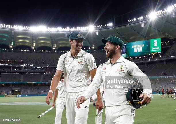 Pat Cummins and Matthew Wade of Australia celebrate victory during day four of the First Test match in the series between Australia and New Zealand...