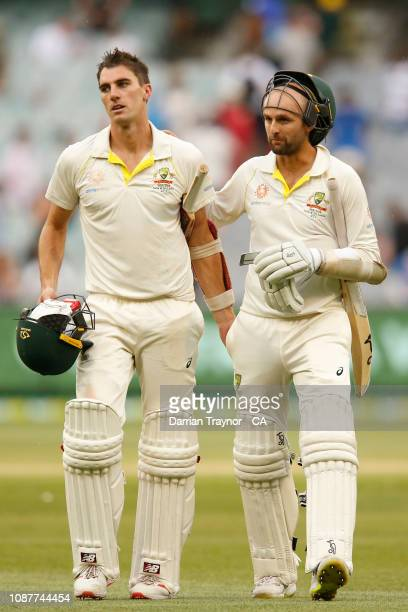 Pat Cummins and Nathan Lyon of Australia walk off the field at the end of play onn day four of the Third Test match in the series between Australia...