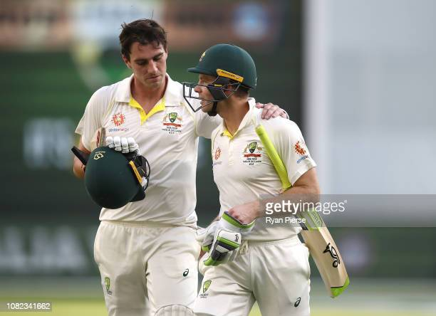 Pat Cummins and Tim Paine of Australia walks from the ground at stumps during day one of the second match in the Test series between Australia and...