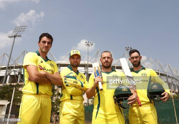 Pat Cummins Carey Aaron Finch and Glenn Maxwell of Australia pose ahead of game one of the One Day International series between India and Australia...