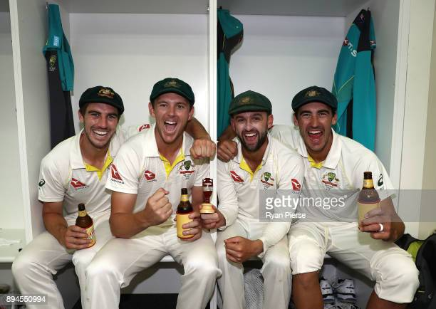 Pat Cummins Josh Hazlewood Nathan Lyon and Mitchell Starc of Australia celebrate in the changerooms after Australia regained the Ashes during day...