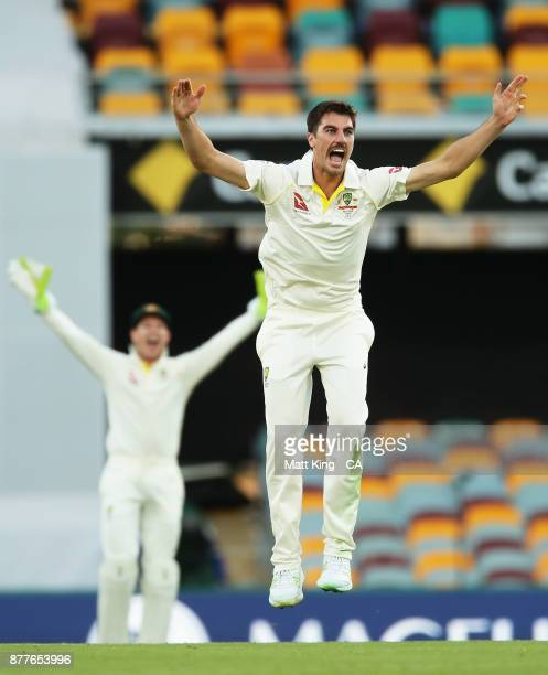 Pat Cummins of Australia appeals successfully for the wicket of Joe Root of England during day one of the First Test Match of the 2017/18 Ashes...