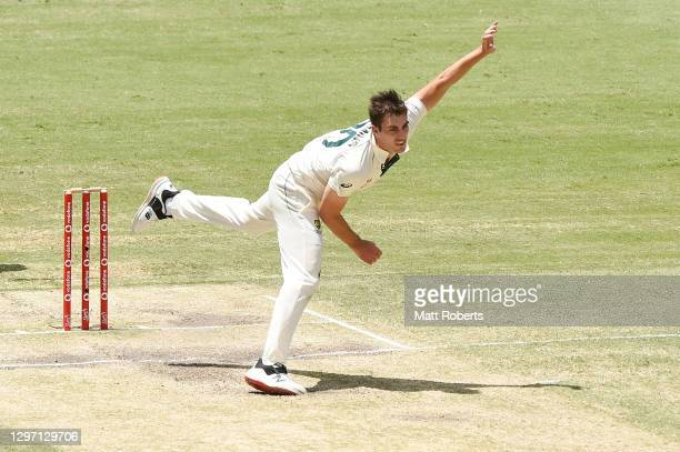 Pat Cummins of Australia bowls during day five of the 4th Test Match in the series between Australia and India at The Gabba on January 19, 2021 in...