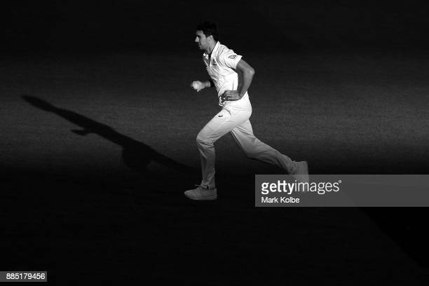 Pat Cummins of Australia bowls during day three of the Second Test match during the 2017/18 Ashes Series between Australia and England at Adelaide...