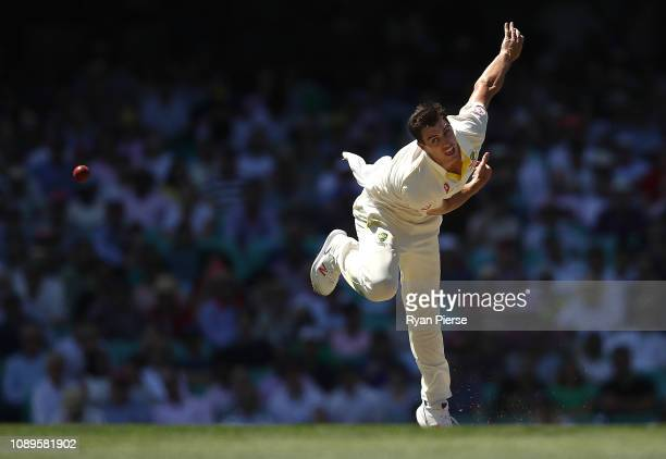 Pat Cummins of Australia bowls during day two of the Fourth Test match in the series between Australia and India at Sydney Cricket Ground on January...