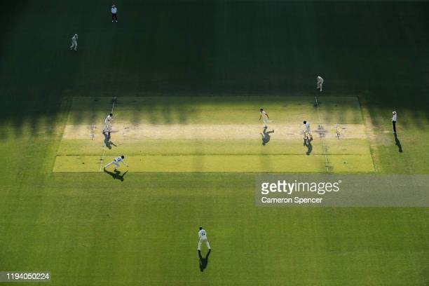 Pat Cummins of Australia bowls to Henry Nicholls of New Zealand during day four of the First Test match in the series between Australia and New...
