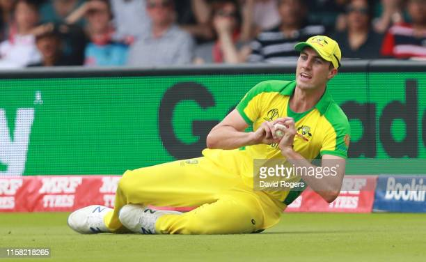 Pat Cummins of Australia catches out Eoin Morgan during the Group Stage match of the ICC Cricket World Cup 2019 between England and Australia at...