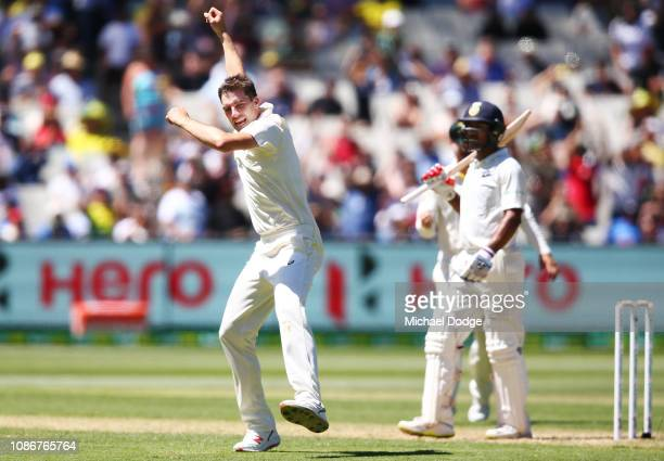 Pat Cummins of Australia celebrates a wicket of Hanuma Vihari of India during day one of the Third Test match in the series between Australia and...