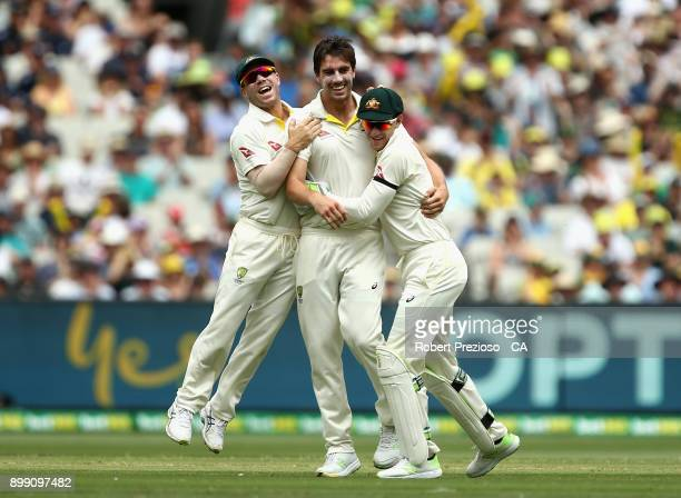 Pat Cummins of Australia celebrates afte taking the wicket of Joe Root of England during day three of the Fourth Test Match in the 2017/18 Ashes...