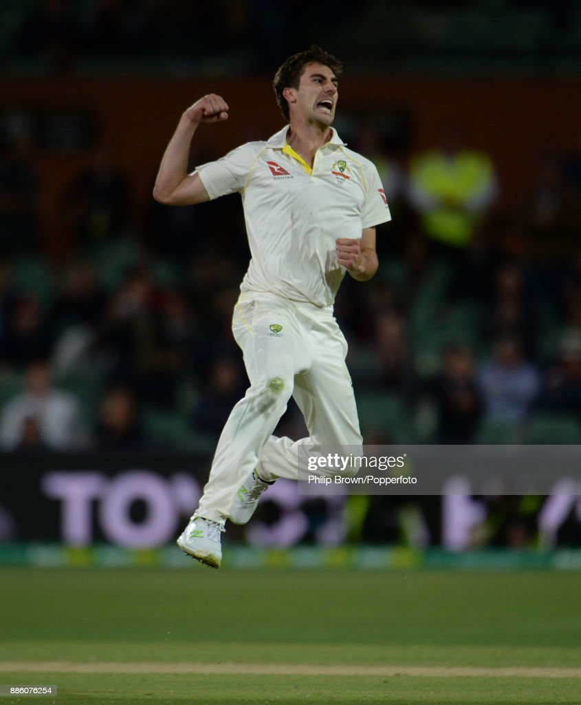 Pat Cummins of Australia celebrates after dismissing Dawid Malan of England during the fourth day of the second Ashes cricket test match between Australia and England at the Adelaide Oval on December 5, 2017 in Adelaide, Australia.