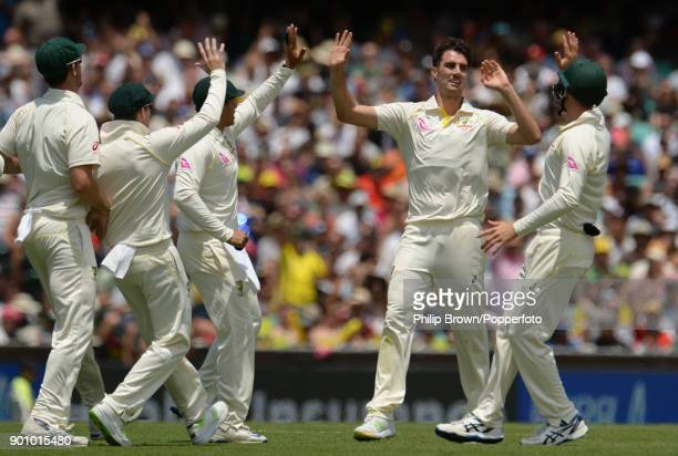 Pat Cummins of Australia celebrates after dismissing Mark Stoneman of England during the first day of the fifth Ashes cricket test match between...