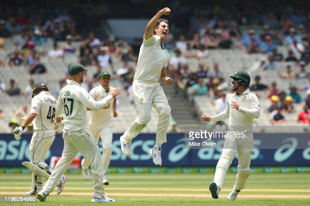 Pat Cummins of Australia celebrates after dismissing Tom Latham of New Zealand during day three of the Second Test match in the series between...