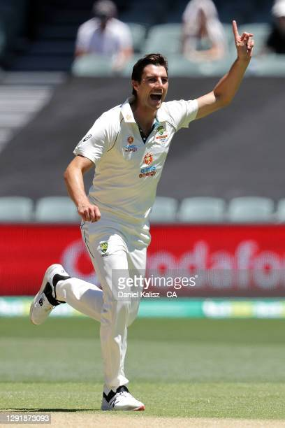 Pat Cummins of Australia celebrates after taking a wicket during day two of the First Test match between Australia and India at Adelaide Oval on...