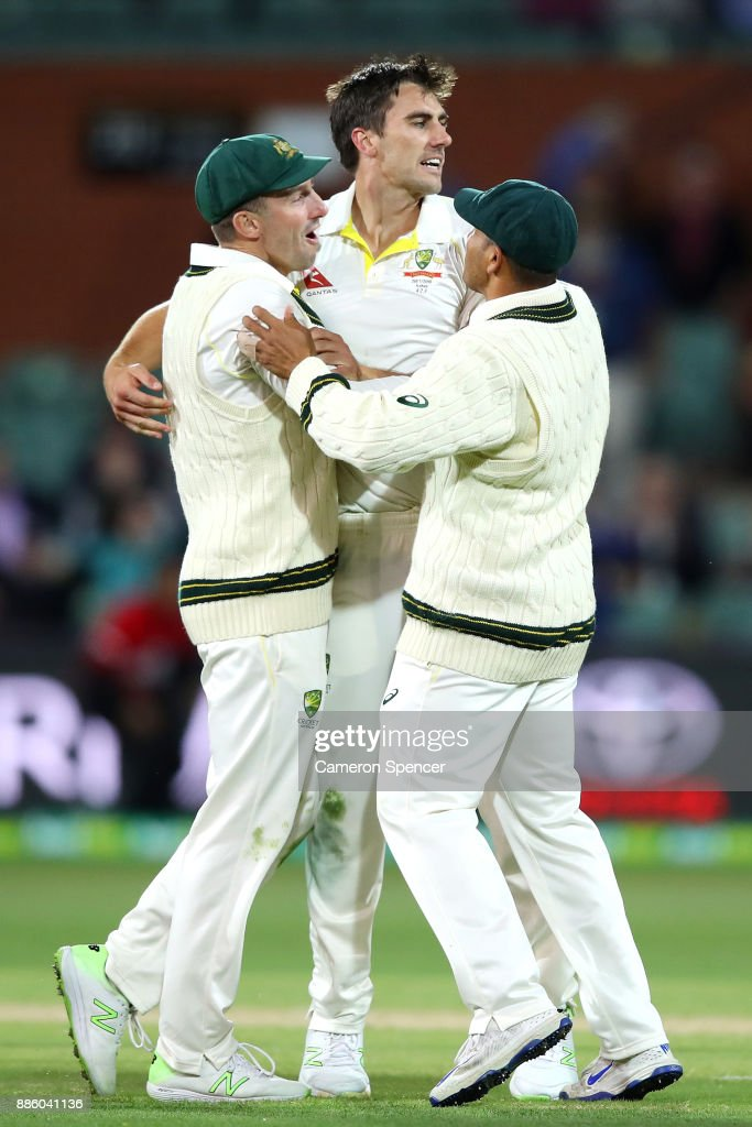 Pat Cummins of Australia celebrates after taking the wicket of Dawid Malan of England during day four of the Second Test match during the 2017/18 Ashes Series between Australia and England at Adelaide Oval on December 5, 2017 in Adelaide, Australia.