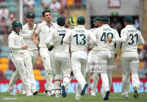 Pat Cummins of Australia celebrates after taking the wicket of Shubman Gill of India during day two of the 4th Test Match in the series between...