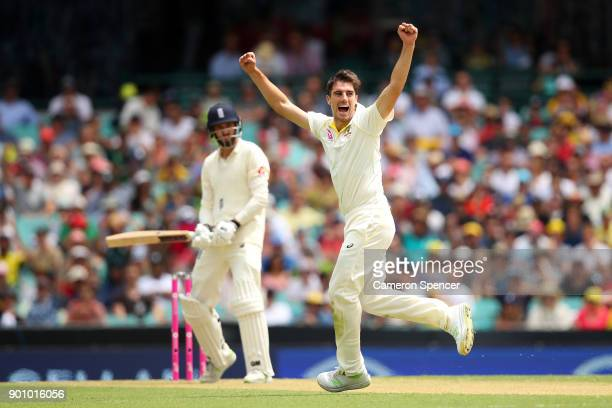 Pat Cummins of Australia celebrates after taking the wicket of James Vince of England during day one of the Fifth Test match in the 2017/18 Ashes...