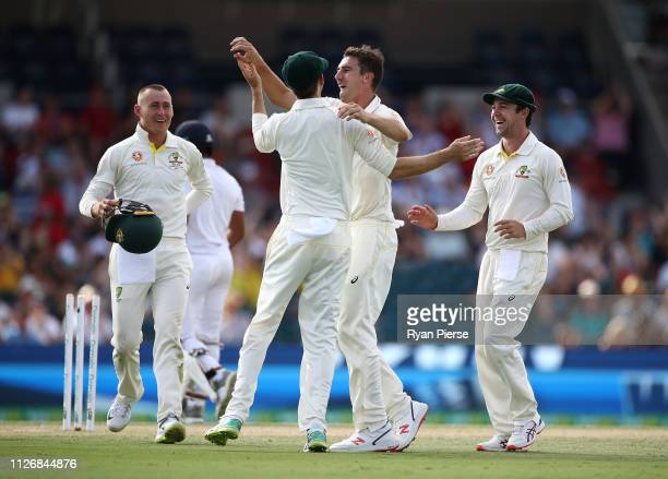 Pat Cummins of Australia celebrates after taking the wicket of Kusal Mendis of Sri Lanks during day two of the Second Test match between Australia...