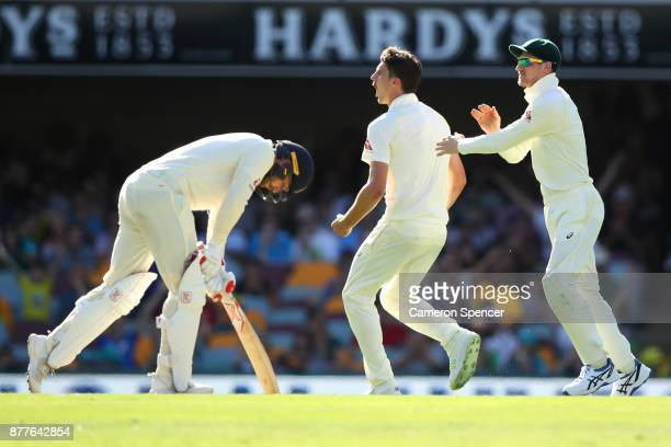 Pat Cummins of Australia celebrates after taking the wicket of Mark Stoneman of England during day one of the First Test Match of the 2017/18 Ashes...