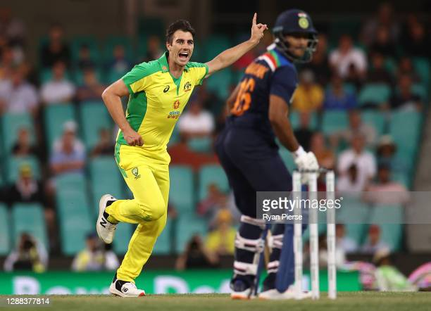 Pat Cummins of Australia celebrates after taking the wicket of Mayank Agarwal of India during game two of the One Day International series between...
