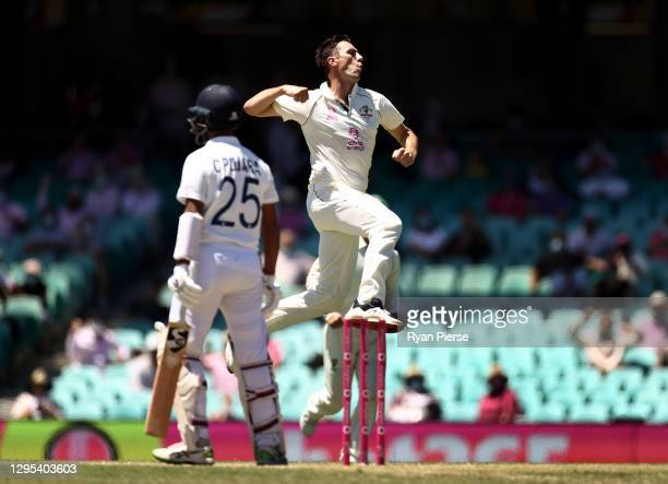 Pat Cummins of Australia celebrates after taking the wicket of Cheteshwar Pujara of India during day three of the 3rd Test match in the series...