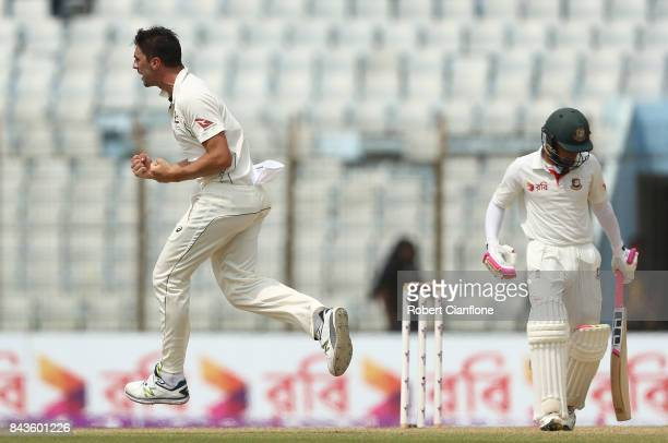Pat Cummins of Australia celebrates after taking the wicket of Mushfiqur Rahim of Bangladesh during day four of the Second Test match between...