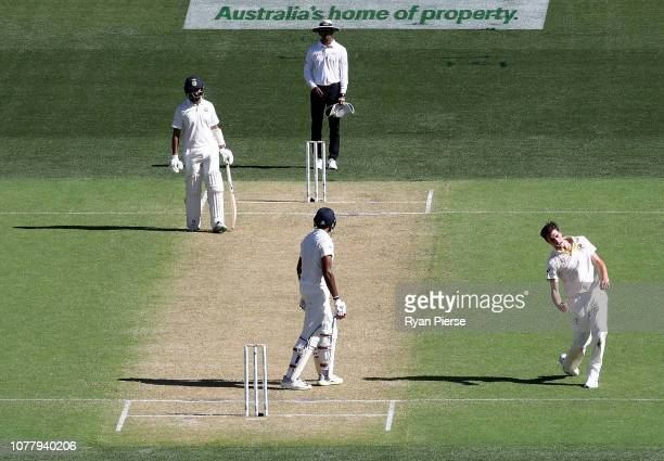 Pat Cummins of Australia celebrates after taking the wicket of Ravi Ashwin of India during day one of the First Test match in the series between...