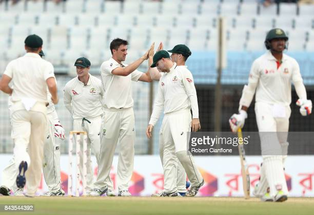 Pat Cummins of Australia celebrates after taking the wicket of Soumya Sarker of Bangladesh during day four of the Second Test match between...