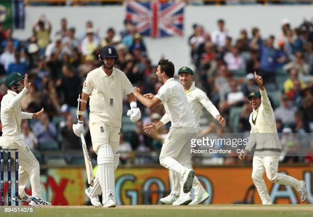 Pat Cummins of Australia celebrates after taking the wicket of Stuart Broad of England during day five of the Third Test match during the 2017/18...