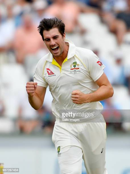 Pat Cummins of Australia celebrates after taking the wicket to dismiss Dean Elgar of South Africa during day 3 of the 3rd Sunfoil Test match between...