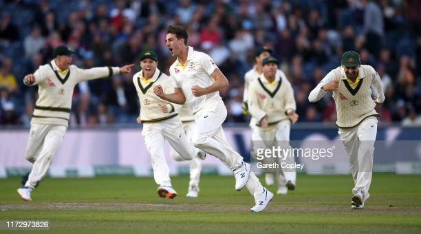 Pat Cummins of Australia celebrates dismissing England captain Joe Root during day four of the 4th Specsavers Ashes Test match between England and...
