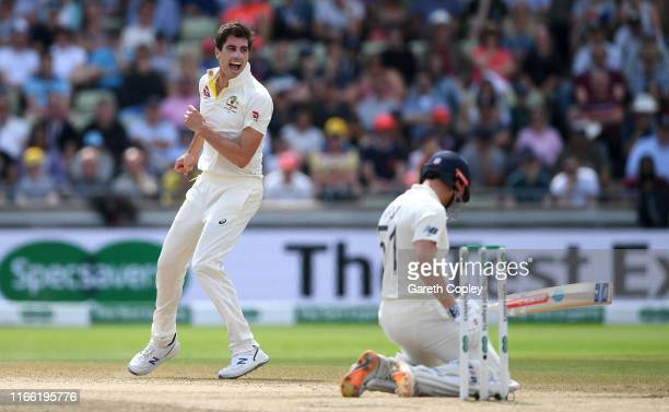Pat Cummins of Australia celebrates dismissing Jonathan Bairstow of England during day five of the 1st Specsavers Ashes Test between England and...