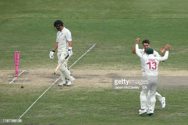 Pat Cummins of Australia celebrates dismissing Ross Taylor of New Zealand during day four of the Third Test Match in the series between Australia and...