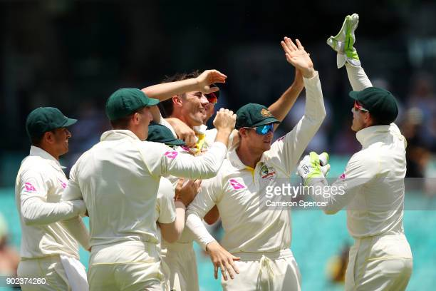 Pat Cummins of Australia celebrates dismissing Stuart Broad of England during day five of the Fifth Test match in the 2017/18 Ashes Series between...