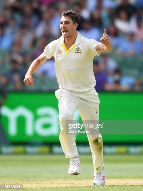 Pat Cummins of Australia celebrates getting the wicket of Ajinkya Rahane of India during day three of the Third Test match in the series between...