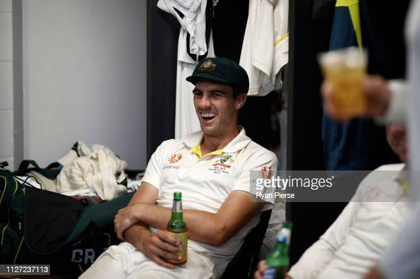 Pat Cummins of Australia celebrates in the change rooms after day four of the Second Test match between Australia and Sri Lanka at Manuka Oval on...