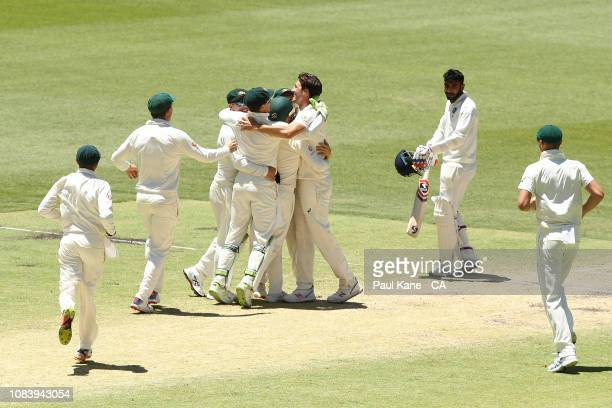 Pat Cummins of Australia celebrates taking a catch of his own bowling to dismiss Jasprit Bumrah of India and to win the match during day five of the...