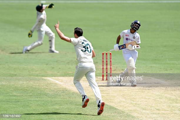 Pat Cummins of Australia celebrates taking the wicket of Ajinkya Rahane of India during day five of the 4th Test Match in the series between...