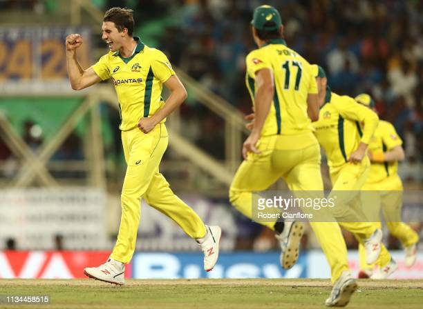 Pat Cummins of Australia celebrates taking the wicket of Ambati Rayudu of India during game three of the One Day International series between India...