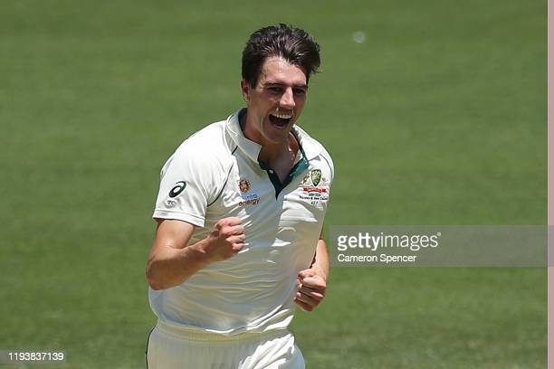 Pat Cummins of Australia celebrates taking the wicket of BJ Watling of New Zealand during day three of the First Test match in the series between...