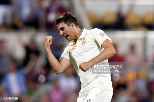 Pat Cummins of Australia celebrates taking the wicket of Dimuth Karunaratne of Sri Lanka during day two of the First Test match between Australia and...