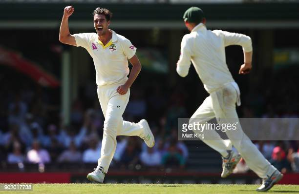 Pat Cummins of Australia celebrates taking the wicket of James Vince of England during day four of the Fifth Test match in the 2017/18 Ashes Series...