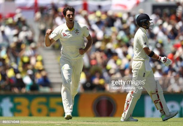 Pat Cummins of Australia celebrates taking the wicket of Joe Root of England during day one of the Third Test match of the 2017/18 Ashes Series...