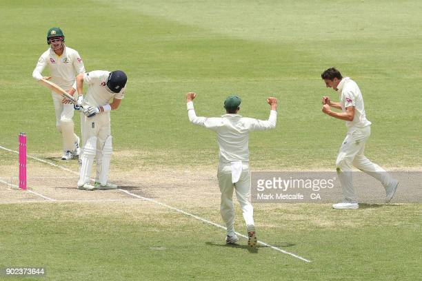 Pat Cummins of Australia celebrates taking the wicket of Jonny Bairstow of England during day five of the Fifth Test match in the 2017/18 Ashes...