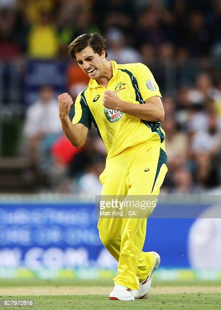 Pat Cummins of Australia celebrates taking the wicket of Martin Guptill of New Zealand during game two of the One Day International series between...