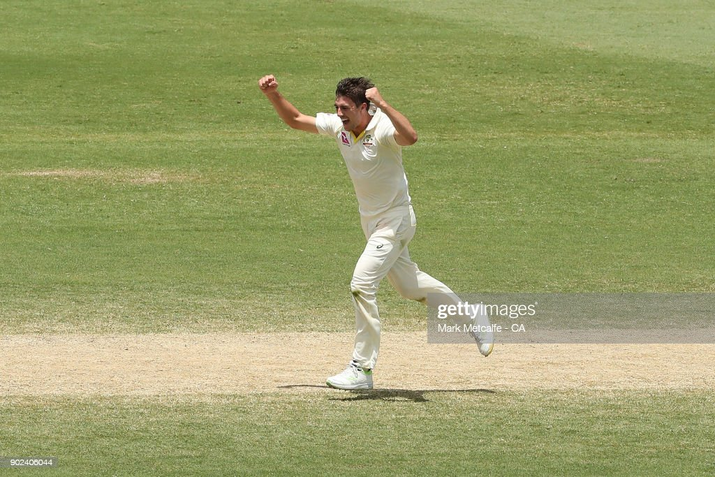Pat Cummins of Australia celebrates taking the wicket of Mason Crane of England during day five of the Fifth Test match in the 2017/18 Ashes Series between Australia and England at Sydney Cricket Ground on January 8, 2018 in Sydney, Australia.